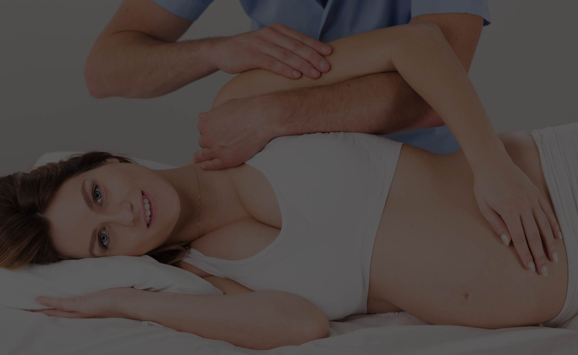 Austin pregnant patient lying on side getting chiropractic treatment